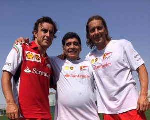 Fernando Alonso, Diego Armando Maradona and former Real Madrid player Michel Salgada / Image: Copyright Ferrari